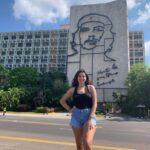 Standing in front of the Plaza de la Revolución in Cuba.