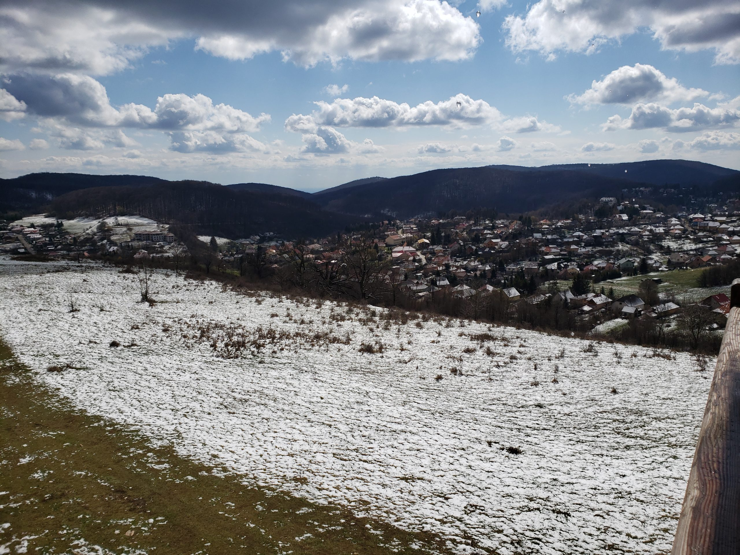 snowy field near hills during daytime