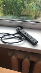 An extension cord on a windowsill.