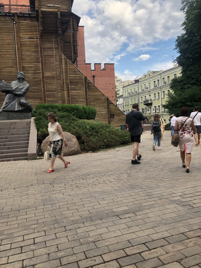 """People walk outside the """"Golden Gates of Kyiv Museum"""""""